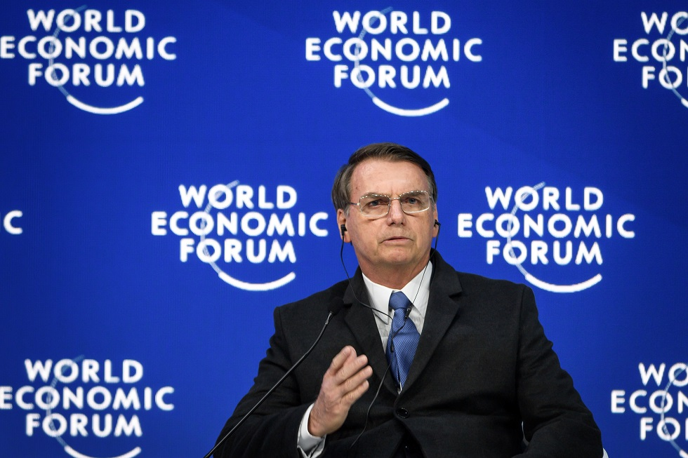 Brazilian President Jair Bolsonaro gestures as he delivers a speech during the World Economic Forum (WEF) annual meeting on January 22, 2019 in Davos, eastern Switzerland.  / AFP / Fabrice COFFRINI